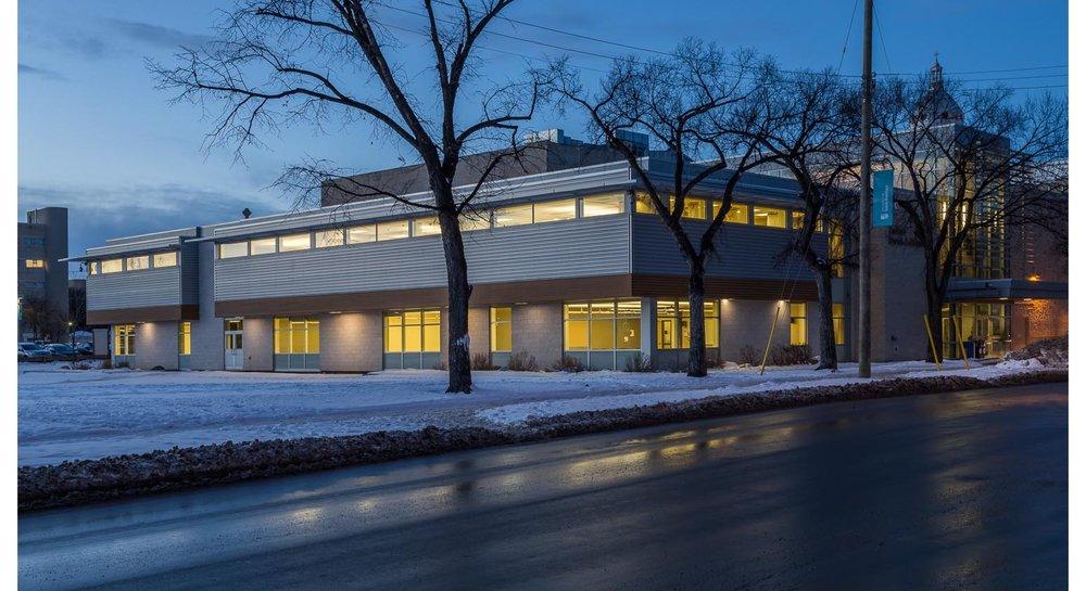 Centre de Santé Marcel A. Desautels, exterior photo of building at dusk / Photo:  Lindsay Reid