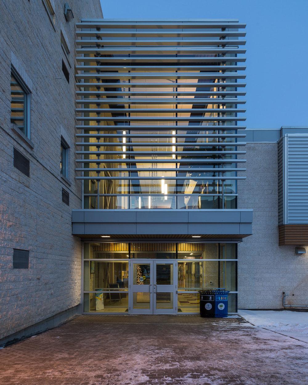 Centre de Santé Marcel A. Desautels, exterior photo of west building entrance / Photo:  Lindsay Reid