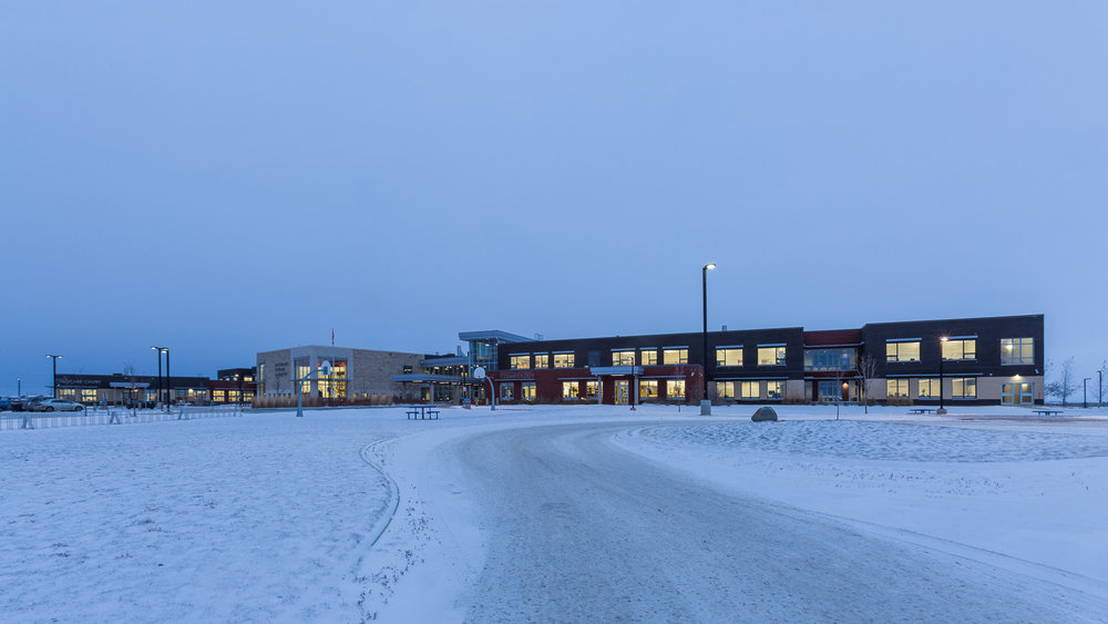 Northlands Parkway Collegiate, exterior photo of the building at dusk / Photo:  Lindsay Reid