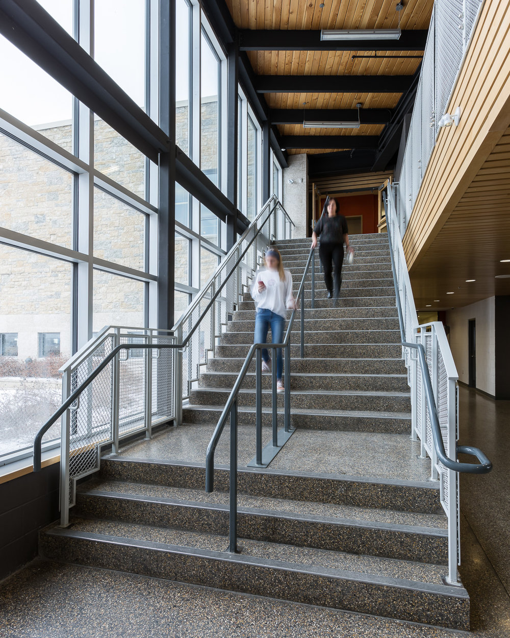 Northlands Parkway Collegiate, interior photo of a staircase / Photo:  Lindsay Reid