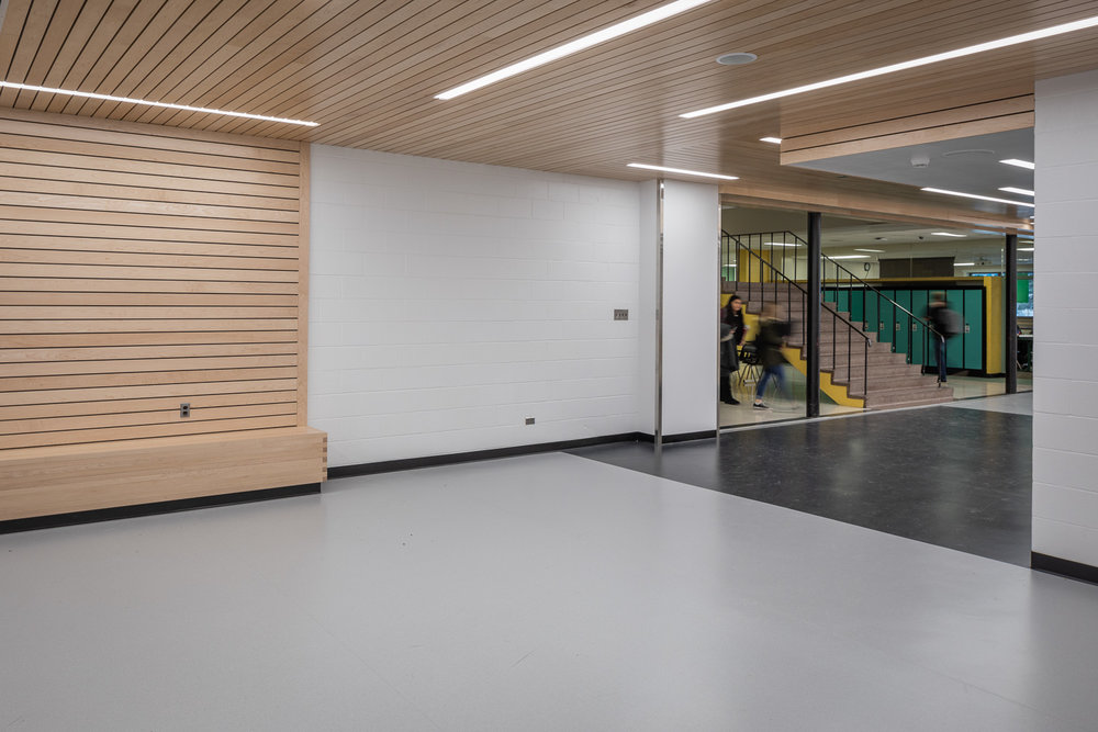 Seven Oaks Performing Arts Centre, interior photo of the lobby connecting to existing school / Photo:  Lindsay Reid