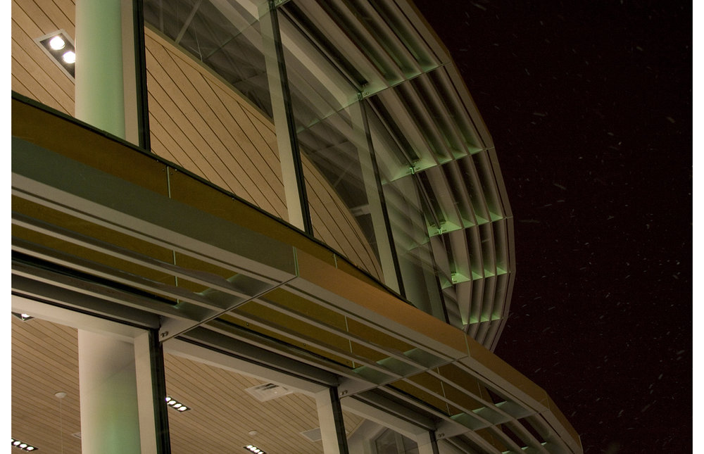 Crosstown Civic Credit Union, exterior detail photo of building windows at night