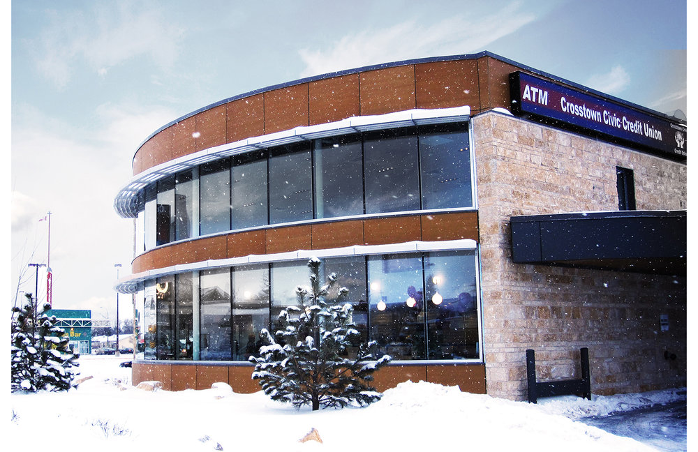 Crosstown Civic Credit Union, exterior photo of building in a snow storm