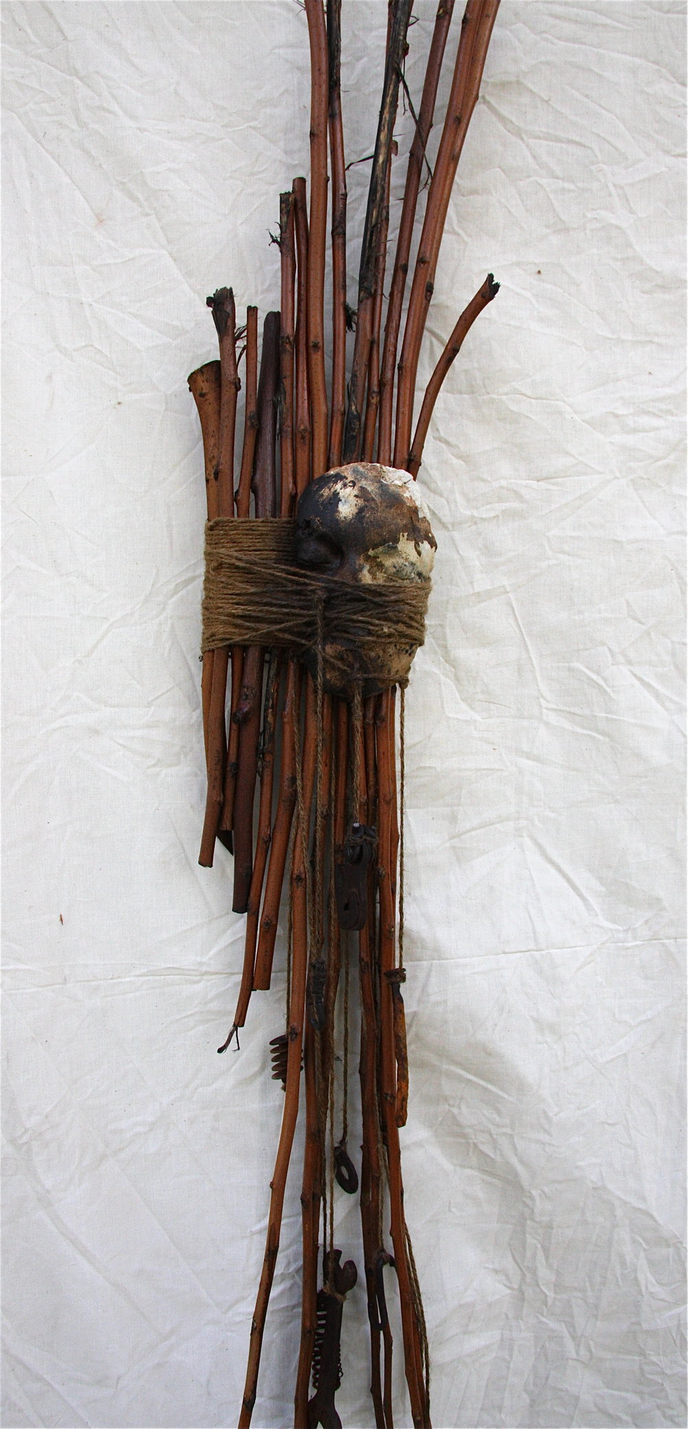 Fragments hang like thoughts from a pre-dawn hour   2010  Ceramic, branches, twine and found objects  75 x 14 x 4