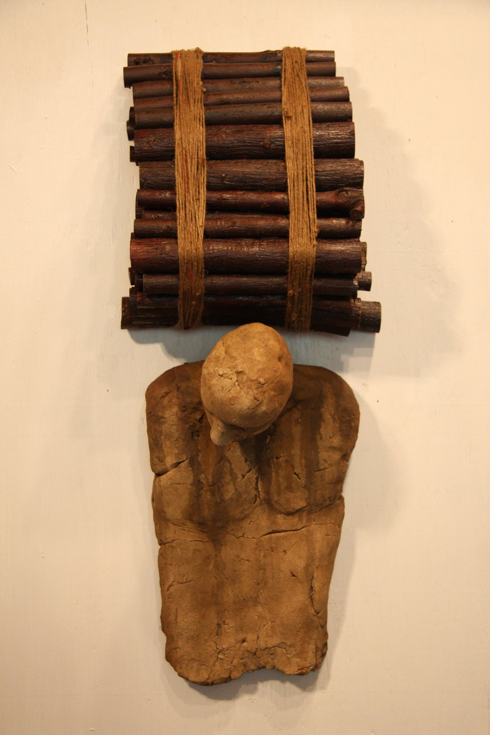 Bearing the altarwood of heaven   2010  Ceramic, wood and twine  36 x 15 x 10