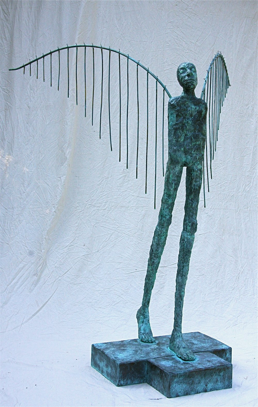 Embracing the rising sun on summer's eve   2009  77 x 82 x 60  Bronze