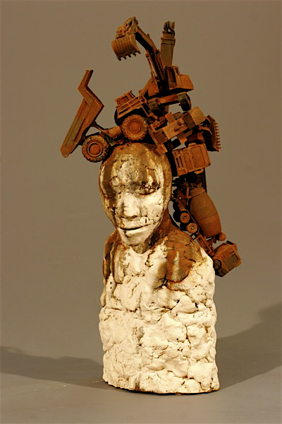 Personal archeology   2005  Ceramic with rusted toys  25 x 9 x 11   Exploring who are and why we are here and where we are going is rooted in understanding what we were and how it makes us into the people we become.