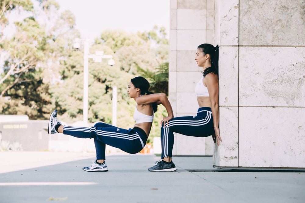 Partner 1 -  30 Tricep Dips. Bend your arms to 90 degrees while holding your partner's knees.  If this feels awkward, have Partner 2 widen their stance. Without letting your elbows splay outwards,push up until your arms are nearly straight. Repeat 30 times.