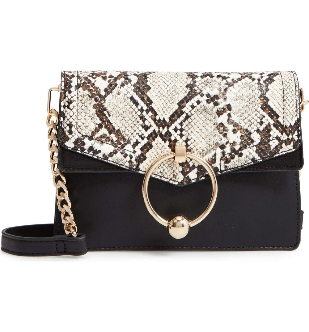 5. PURSE - Fun Topshop bag! Ties it all together.Click here $48