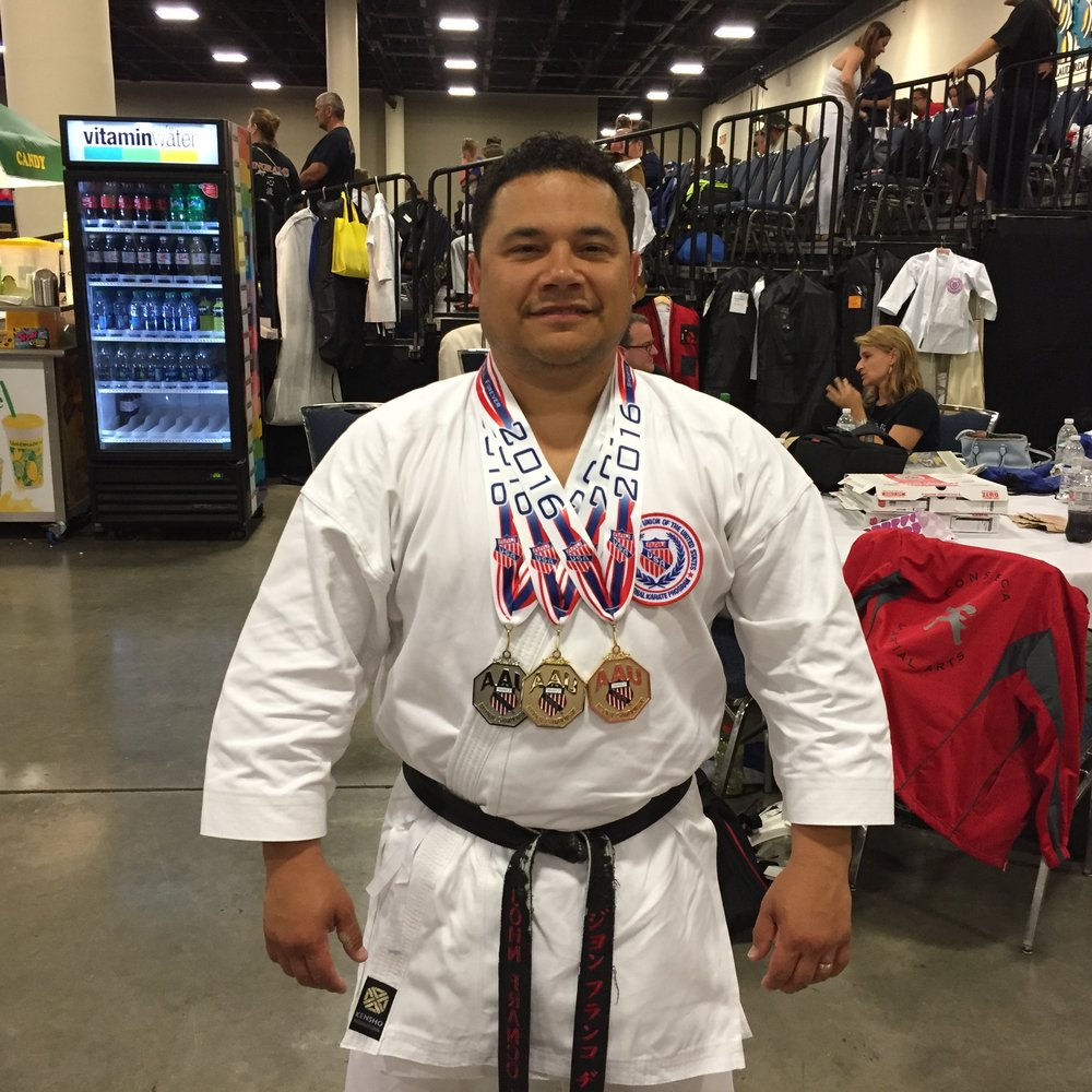 Shihan with Medals.JPG