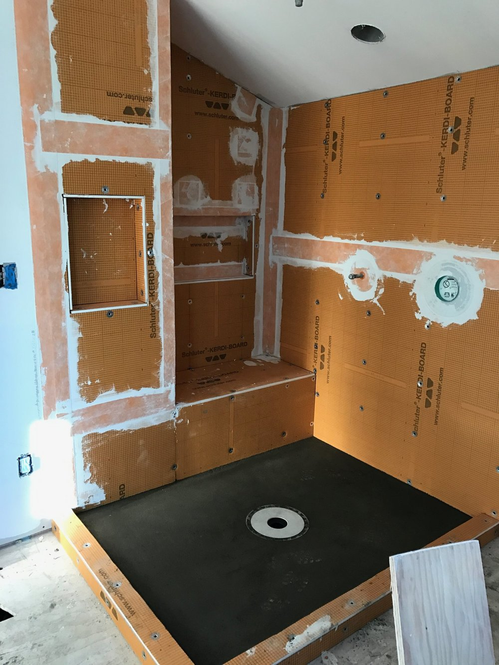 Here at OBI we are big fans of the Schluter/Kerdi waterproofing system for our tile assemblies This both allows a seamless transition to the adjoining walls but is light and the best waterproofing possible!