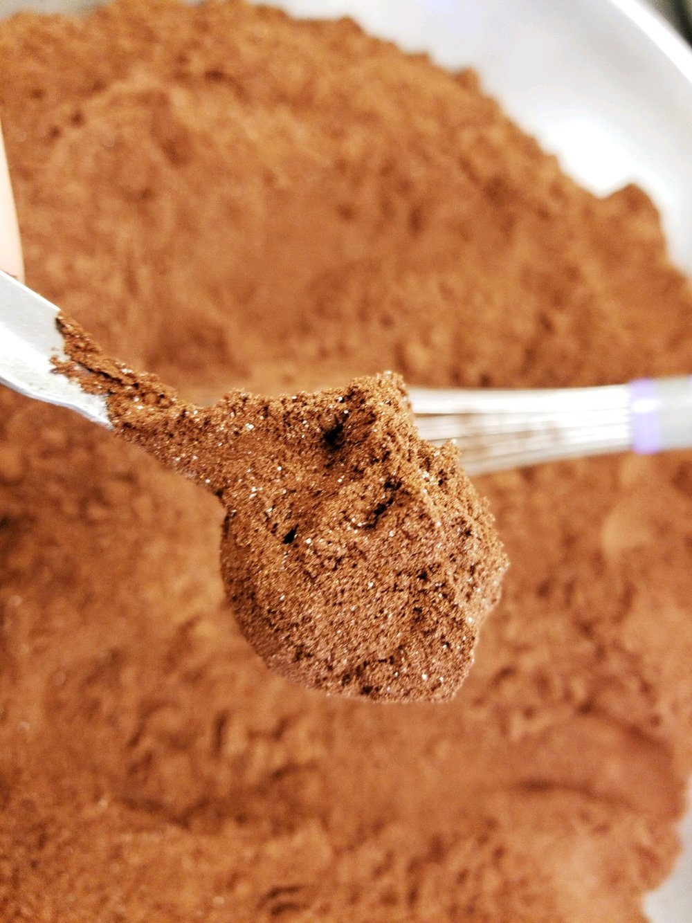 red and black cocoa - We use the best supplier of cocoa on the market. They are well-known for their high quality practices and their cocoa is Fair Trade Certified, non-GMO, and gluten and peanut free. Our Smart Cocoa is a blend of red and black cocoa. Red cocoa is higher in fat with a rich, fudgy and robust chocolate flavor. Black cocoa, used more to flavor our blend, is alkalized for less bitterness and a smooth flavor.
