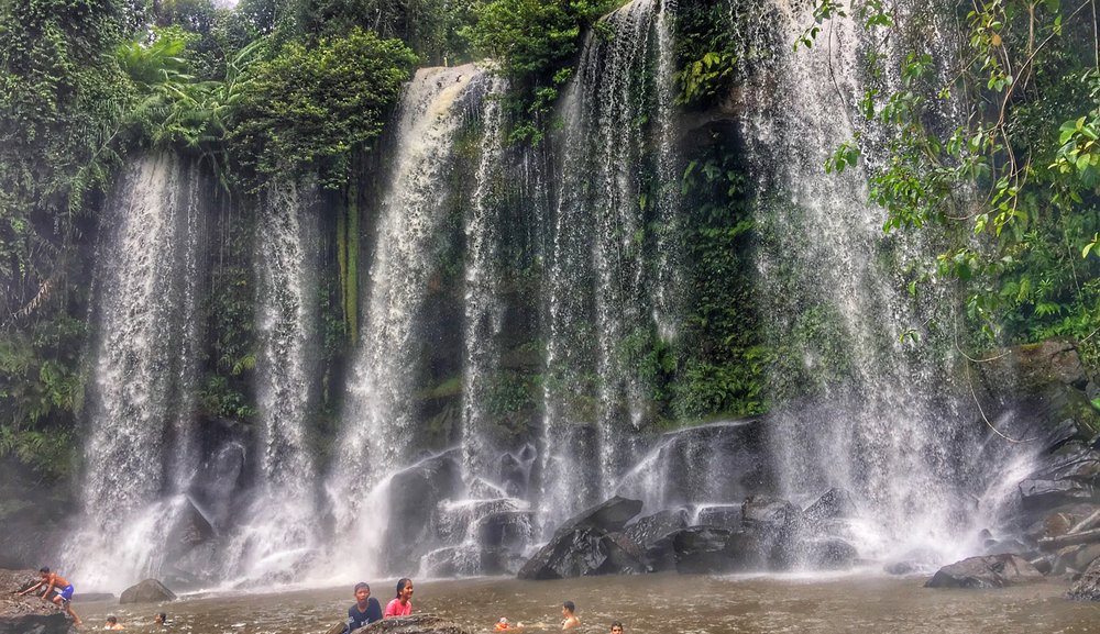 Relaxing at thousand-lingas'  waterfall    Learn more →
