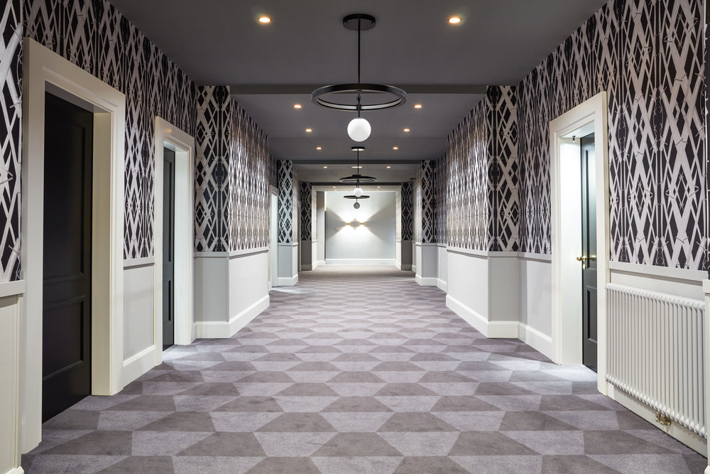 Hotel corridor with Meadow Grass Black wallpaper