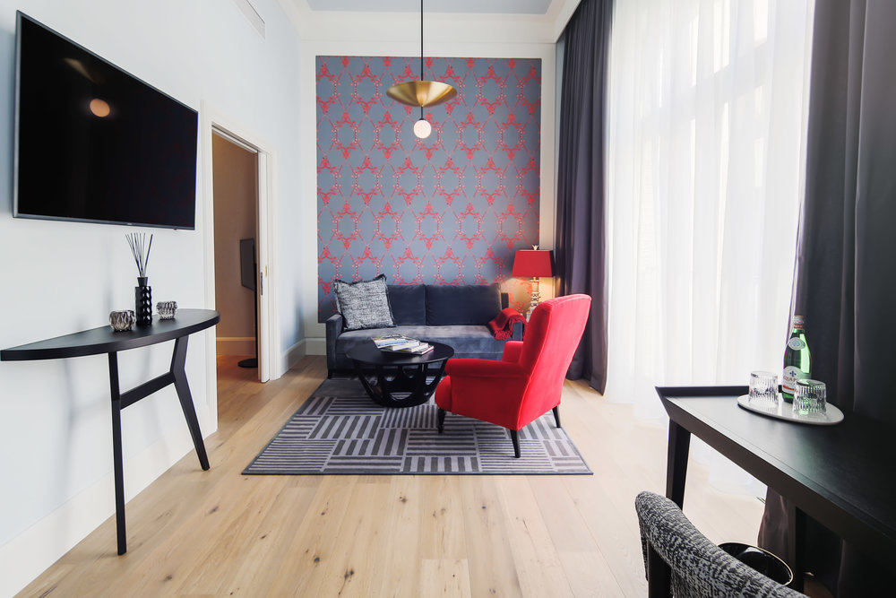 Apartment suite with Morning Glory wallpaper in custom Red