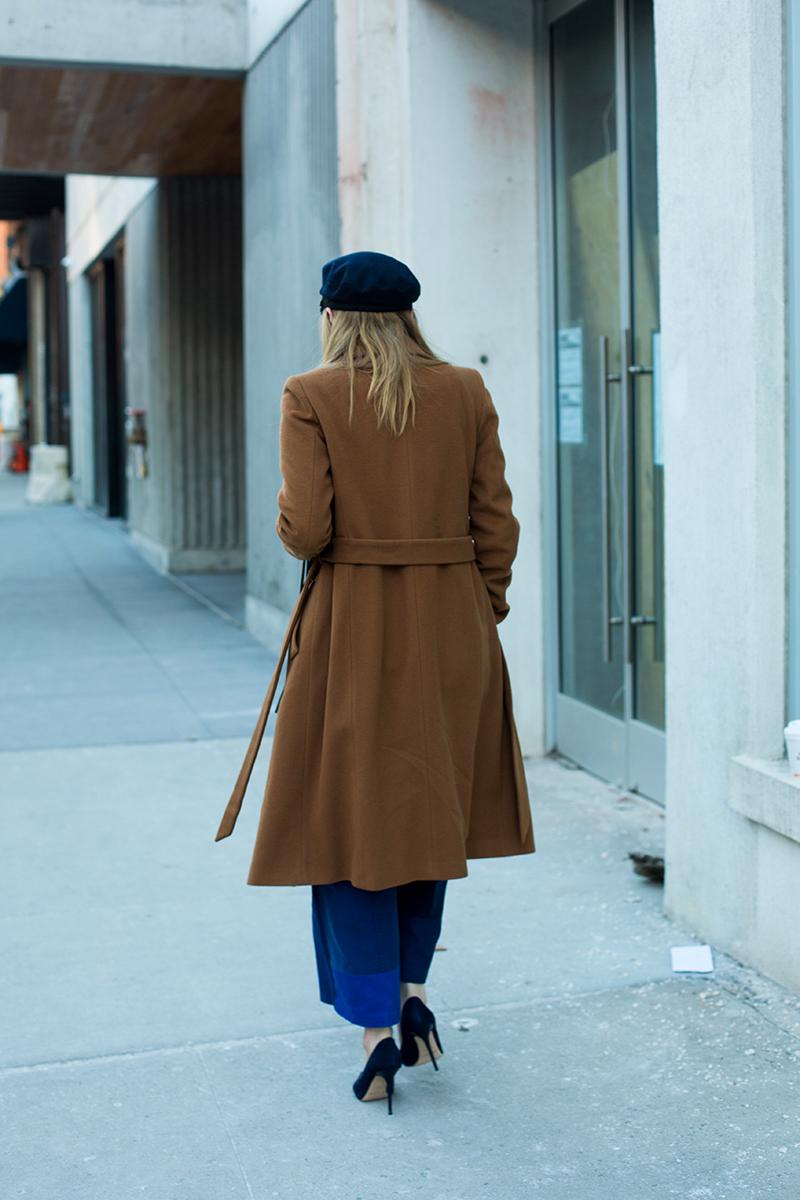camel coat and denim