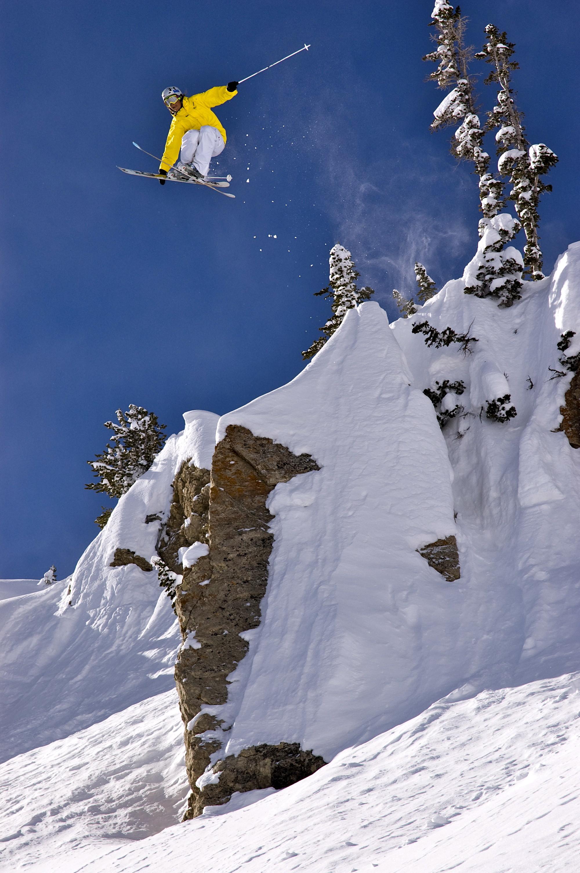 Jen Hudak jumping a cliff at Rocky Point at Alta, Utah