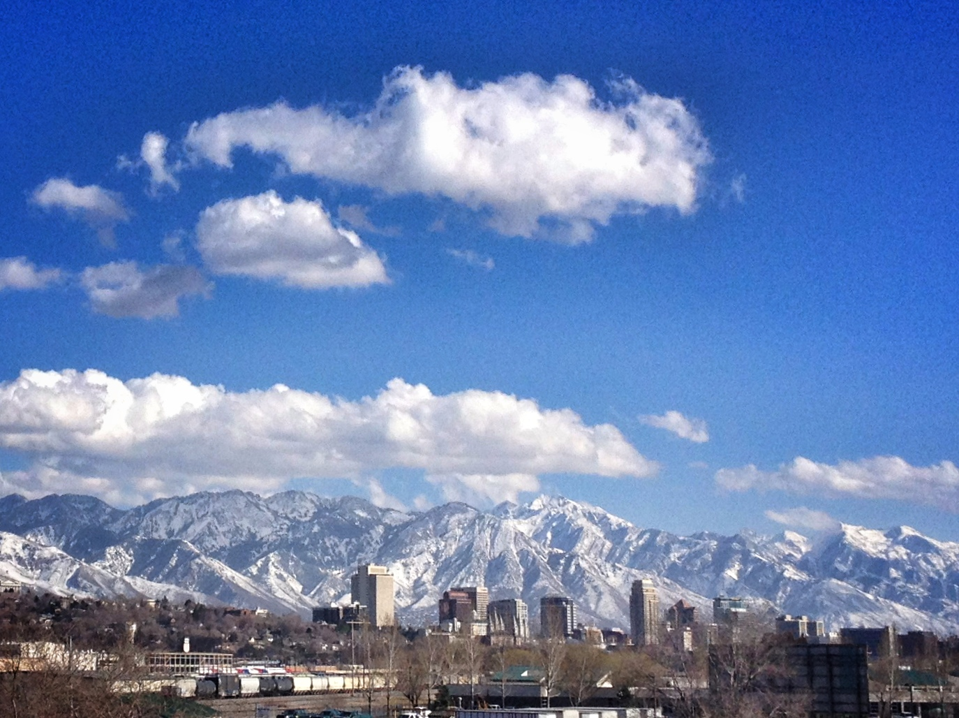 The Salt Lake City skyline juxtaposed against the Wasatch Mountains. Home.