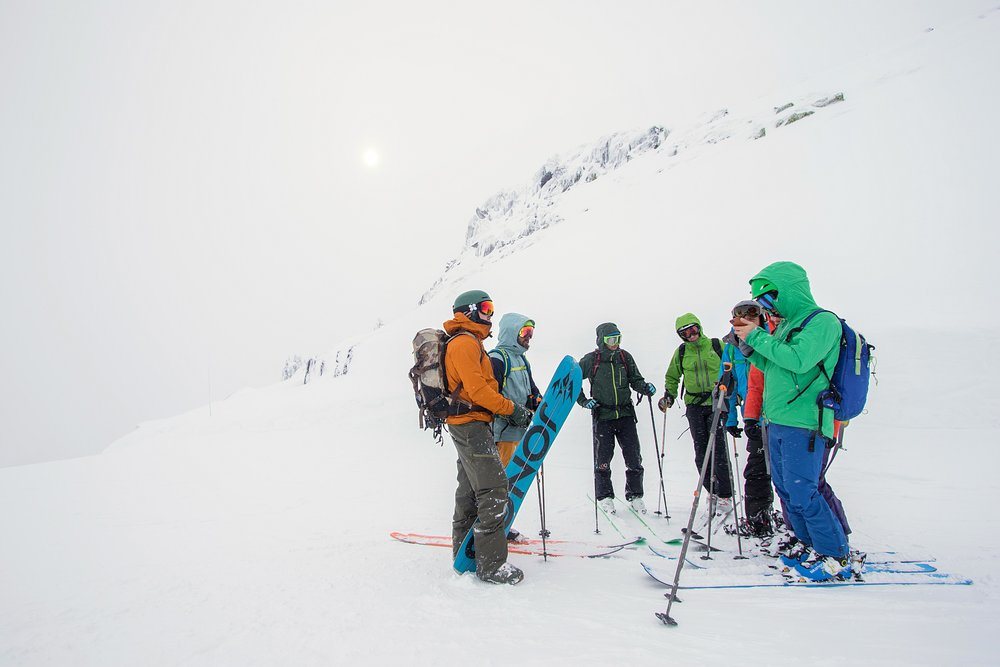 FATMAP Team looking for a route down during a whiteout.