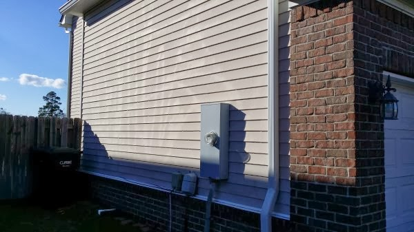 More Siding - Once again, this was done by the neighbor, gardener, family friend, who used a personal machine. Streaks, stripes, and scratches are a possible outcomes when going with this option.