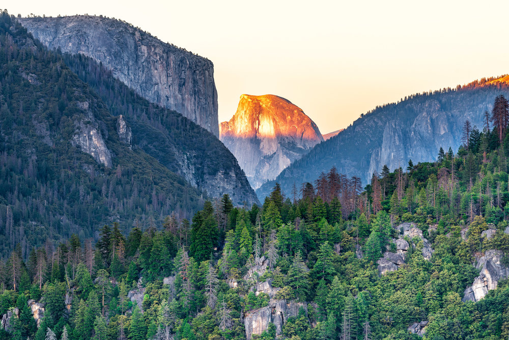 "Sunset light on Half Dome (1/13 sec at f/8.0, iso64, 70-200mm len @160mm) GPS Coordinate: 37°42'49.2""N 119°43'38.5""W"