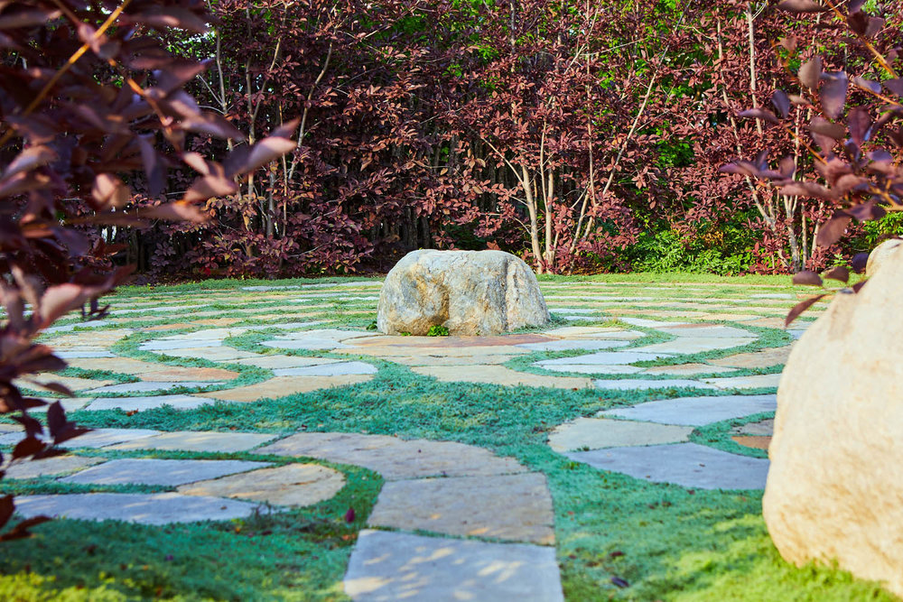 LABYRYINTH - Explore the serenity of moving meditation in the Peace Garden's Labyrinth wrought from hand-cut sandstone enveloped in Wooly Thyme and surrounded by Canada Red Chokecherry trees. Enter the sacred space with your intention. As you walk gently on Mother Earth, listen and receive from all that surrounds you and lies within. As you make it to the center, hold within your heart what has arisen — knowledge, insight, wisdom, and love. Then, as you work your way outwards, through the spiral, consider how you will share the gifts received on your journey of self-discovery.