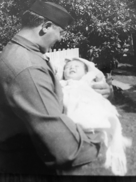 soldier holding baby.JPG