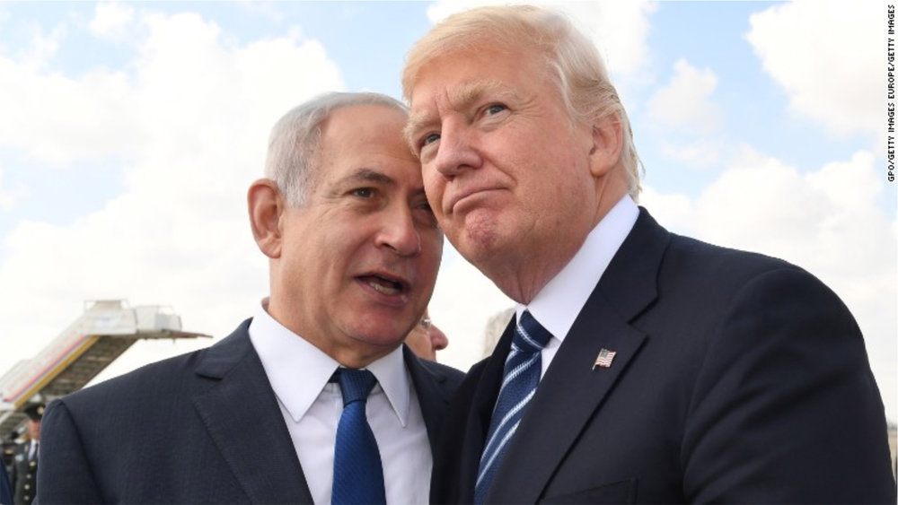 """Trump draws inspiration for his border wall from Israel's separation wall. """"A wall protects. All you have to do is ask Israel."""" - Trump to Sean Hannity on Fox News.   Image: KOBI GIDEON/GETTY IMAGES"""