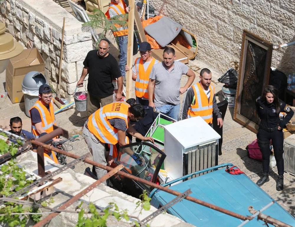 "One of the main sites Birthright takes participants is the ""City of David"" located in East Jerusalem neighborhood of Silwan and owned by Elad, a settler organization that uses the funds to evict Palestinians in the neighborhood. This image shows the eviction of a Palestinian family from Silwan in April 2018.  Image: Emil Salman"