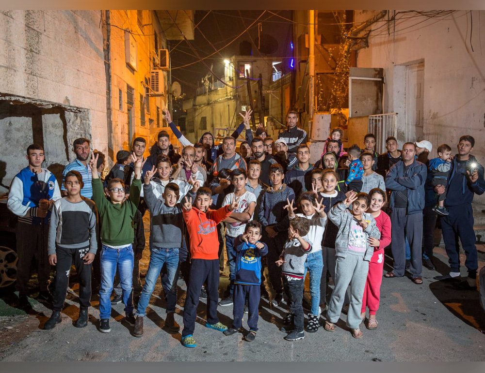 Just last month, Israeli courts rules that 700 Palestinians living in Silwan will be evicted by Elad and their allies to make room for this Jewish settlement. Birthright participants don't hear that story — or any other stories of the realities of Occupation for millions of Palestinians living in East Jerusalem, the West Bank, and Gaza. This images shows residents of Silwan.  Image: Emil Salman