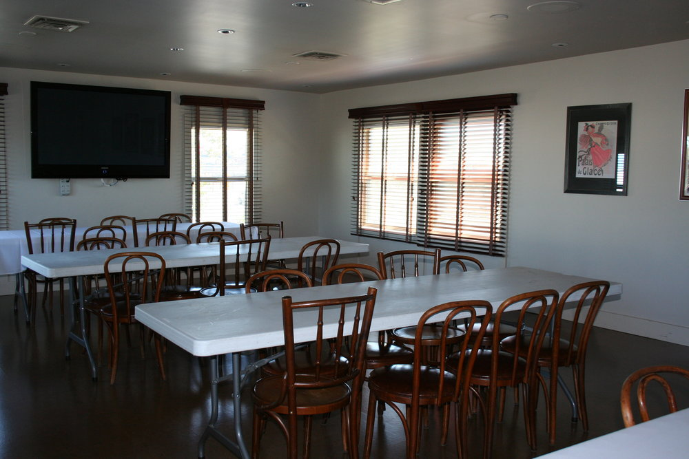Upstairs Banquet Room - This space is perfect for offsite meetings, office parties, family gatherings and holiday events. The room holds up to 40 guests and has internet connectivity as well as A/V equipment for any presentation or slide show.