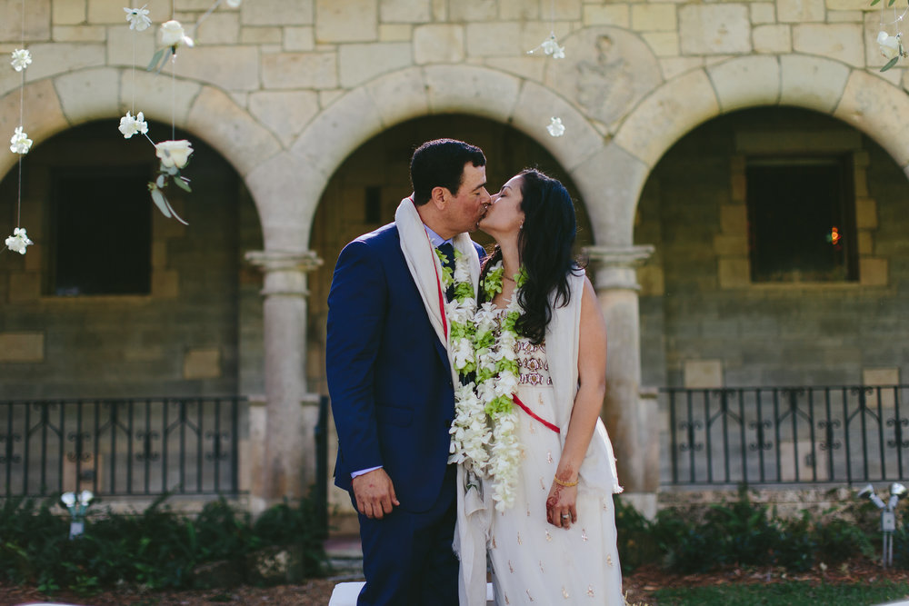 bride-groom-kiss-miami-international-wedding-photographer-tiny-house-photo.jpg