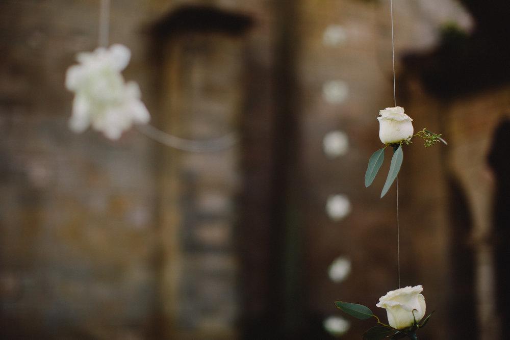 hanging-flowers-indian-wedding-spanish-monastery-tiny-house-photo.jpg