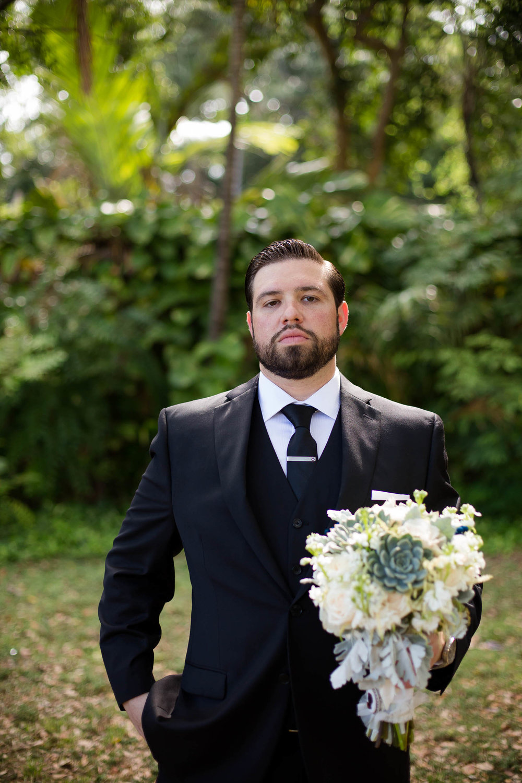 groom_bouquet_wedding_humor_tiny_house_photo.jpg