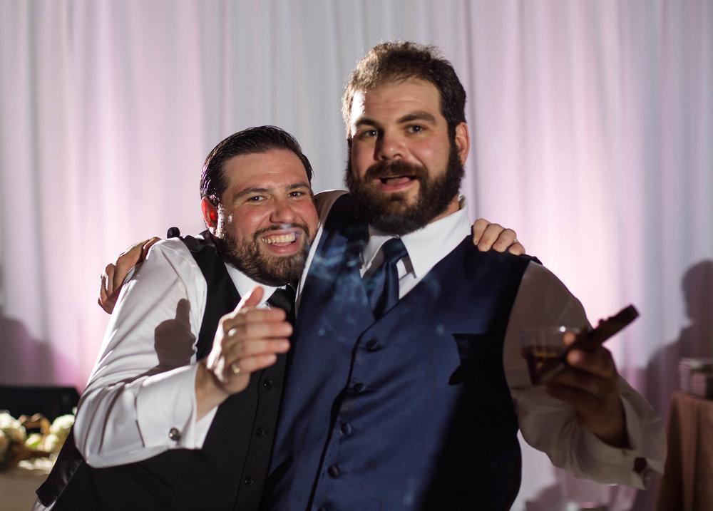 groom_friend_moments_cigar_fun_wedding_tiny_house_photo.jpg