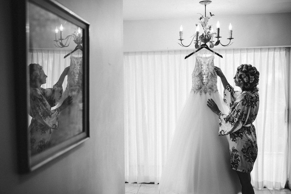 bride-dress-hanging-black-and-white-tiny-house-photo-florida-wedding-photographer.jpg