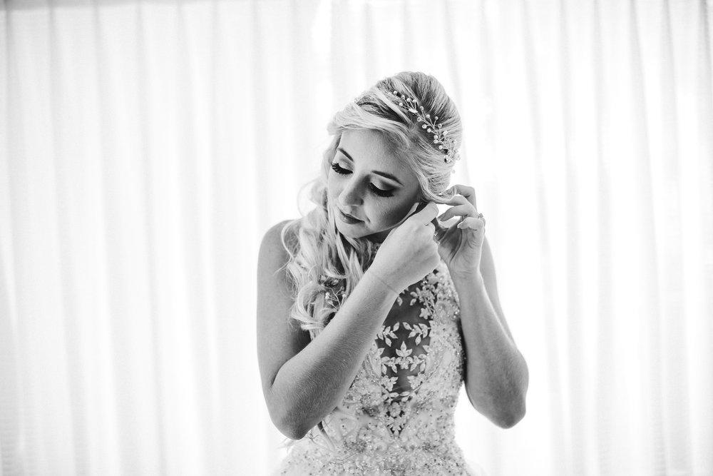bride-earings-emotion-tiny-house-photo-florida-wedding-photographer.jpg