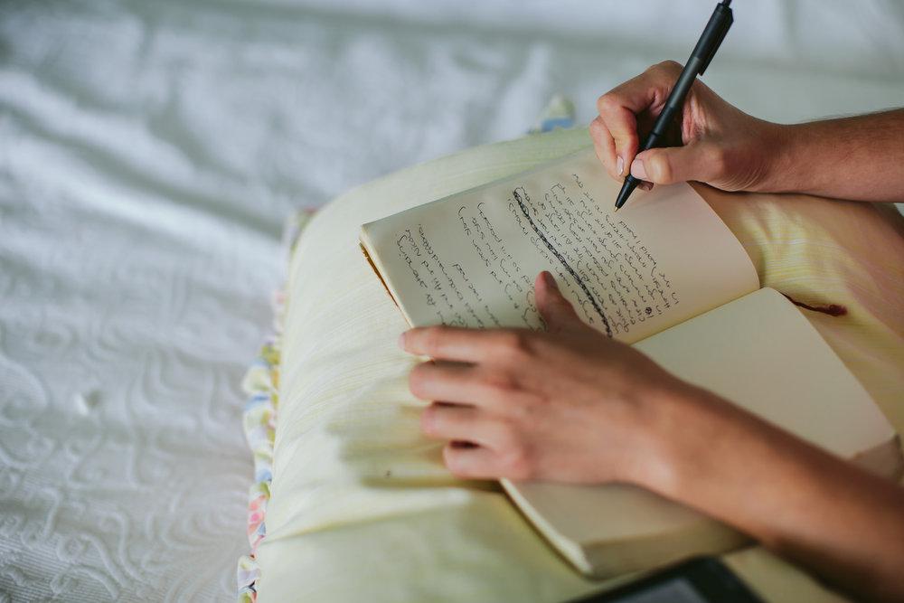 details-getting-ready-tiny-house-photo-bridesmaid-writing.jpg