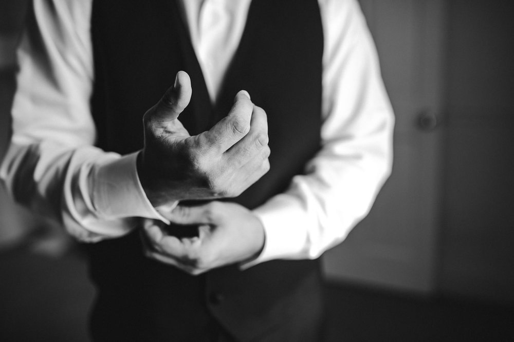 groom-getting-ready-wedding-day-tiny-house-photo.jpg