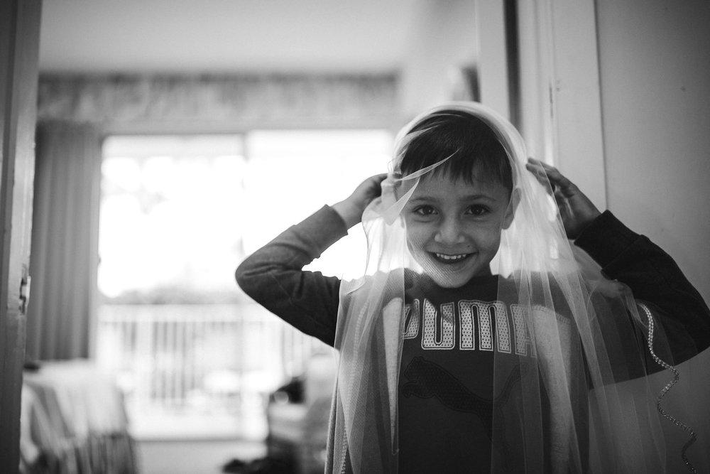 ring-bearer-antics-wedding-day-fun-tiny-house-photo-black-and-white.jpg