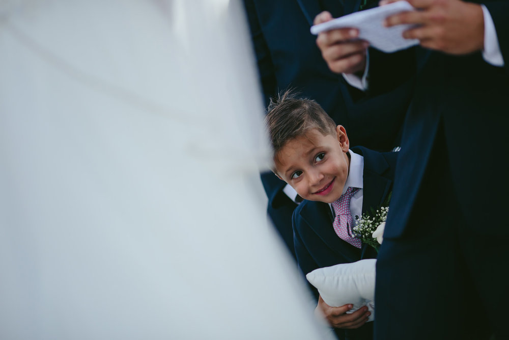 ring-bearer-being-cute-ceremony-moments-love-tiny-house-photo.jpg