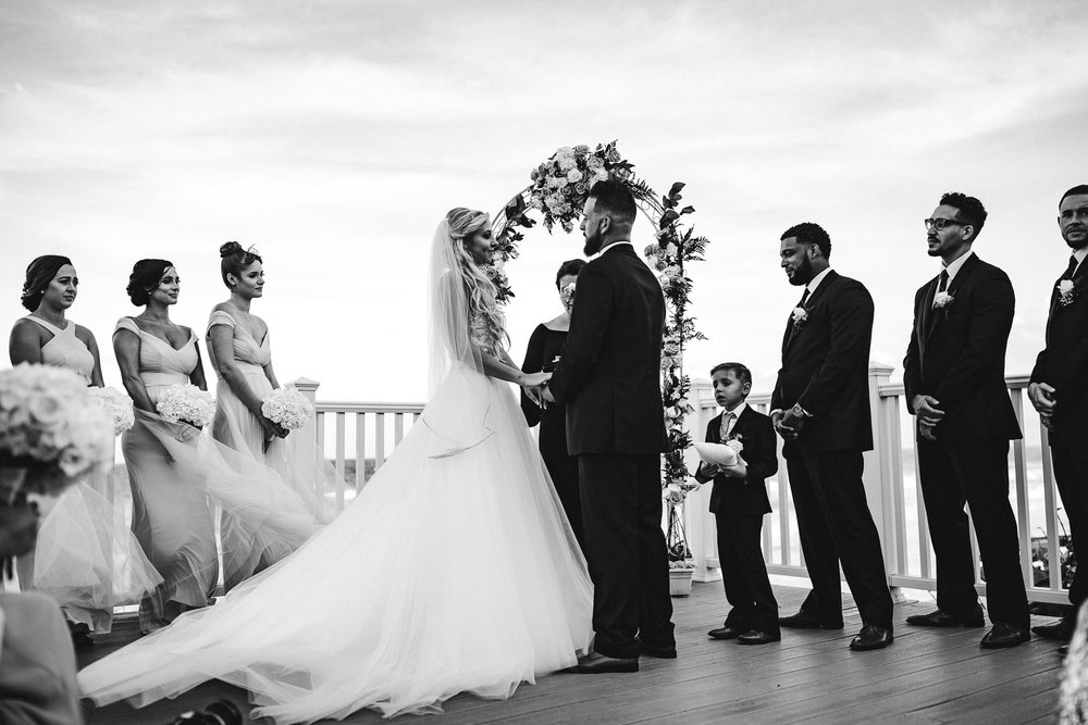 black-and-white-beach-wedding-ceremony-tiny-house-photo.jpg