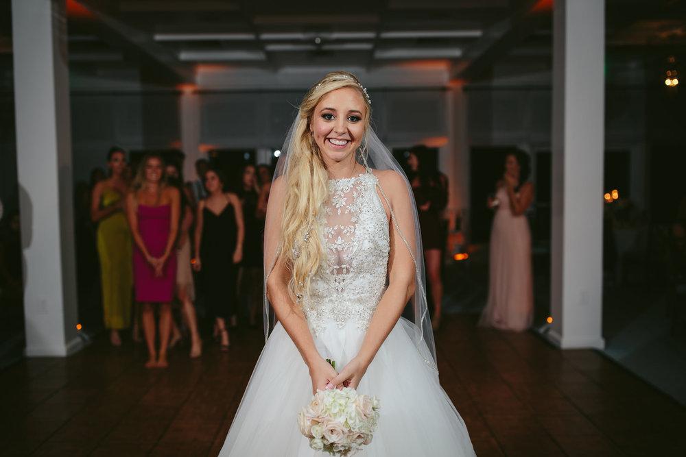 bride-bouquet-toss-wedding-tiny-house-photo.jpg