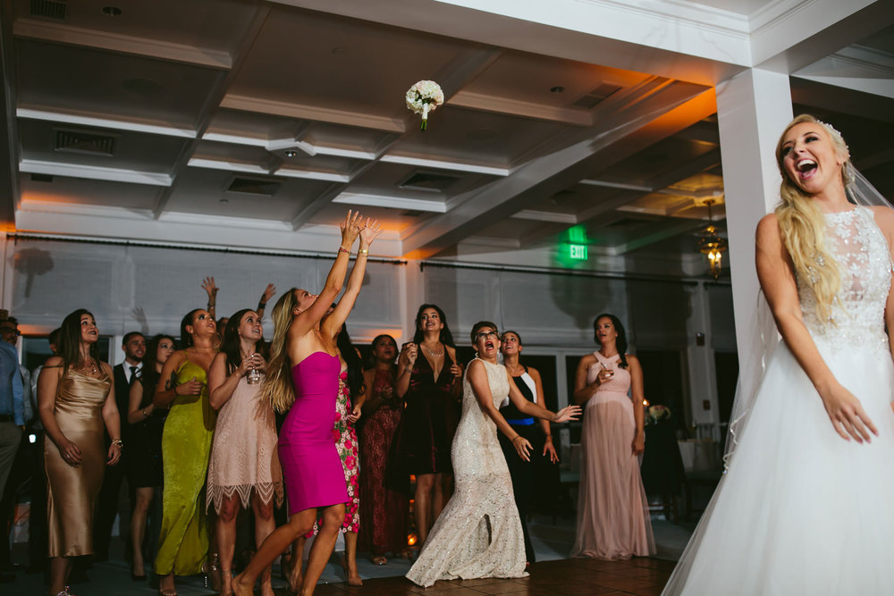 epic-bouquet-toss-moments-tiny-house-photo.jpg
