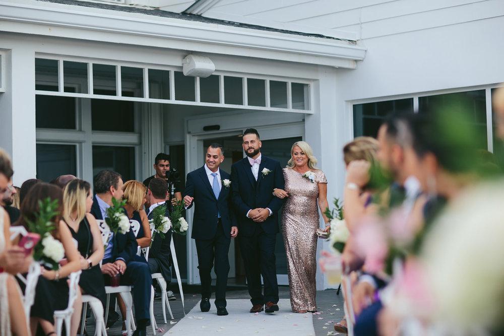 groom-parents-ceremony-walk-wedding-day-tiny-house-photo.jpg