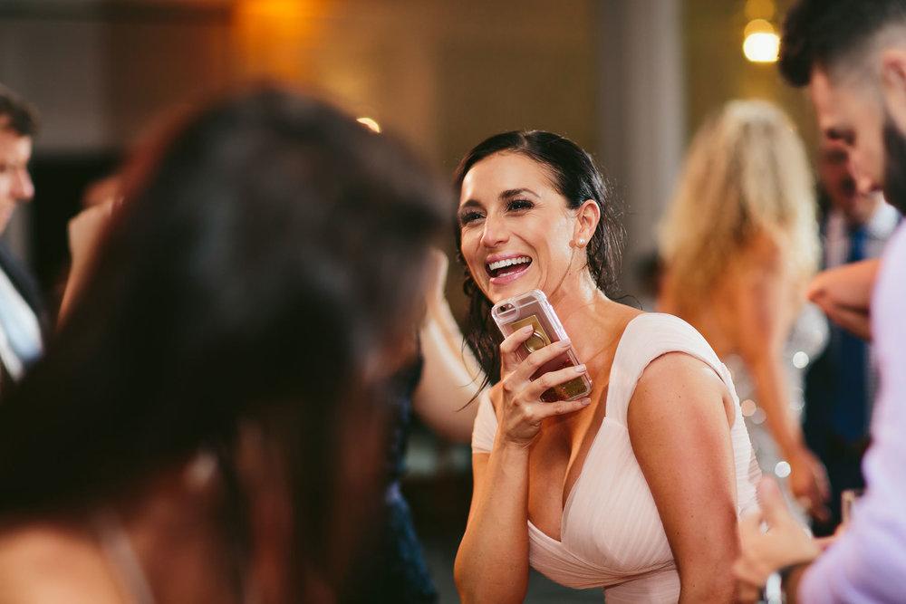laughter-reception-fun-hillsboro-beach-club-wedding-tiny-house-photo.jpg
