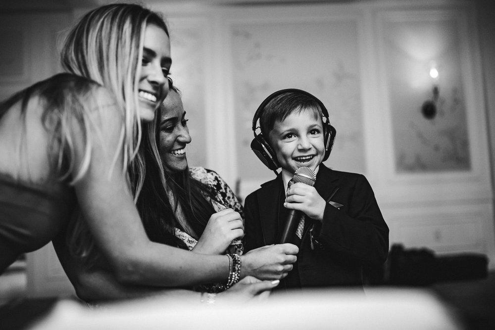 ring-bearer-kids-at-weddings-black-and-white-dj-fun-tiny-house-photo.jpg
