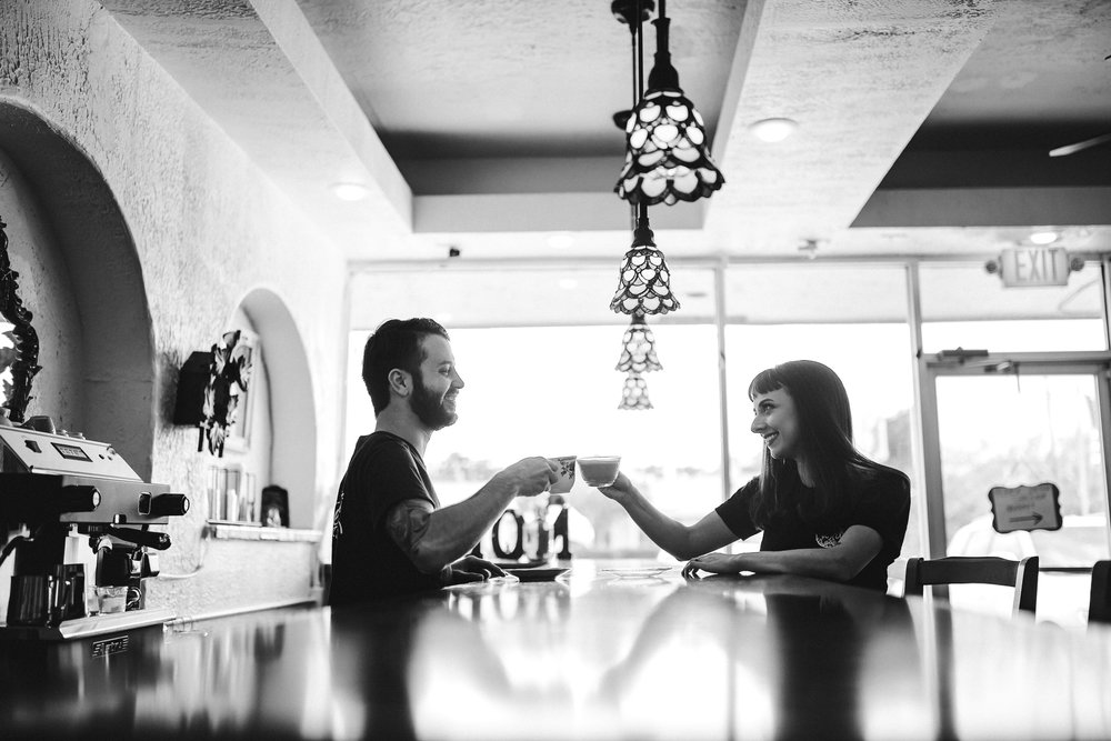 cheers-happy-couple-engagement-toast-future-love-tiny-house-photo-weddings.jpg