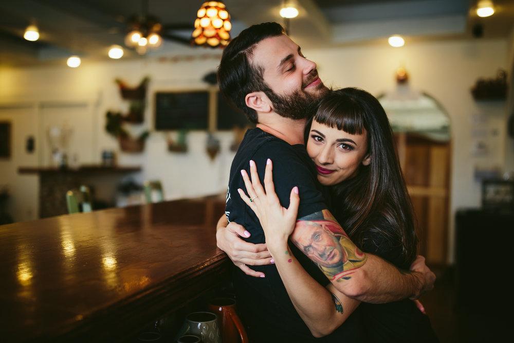cute-couple-embrace-happy-engagement-wedding-photographer-south-florida-tiny-house-photo.jpg