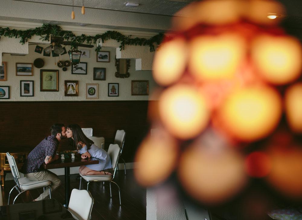 cutesy-engagement-session-kissing-cafe-tiny-house-photo-orlando.jpg